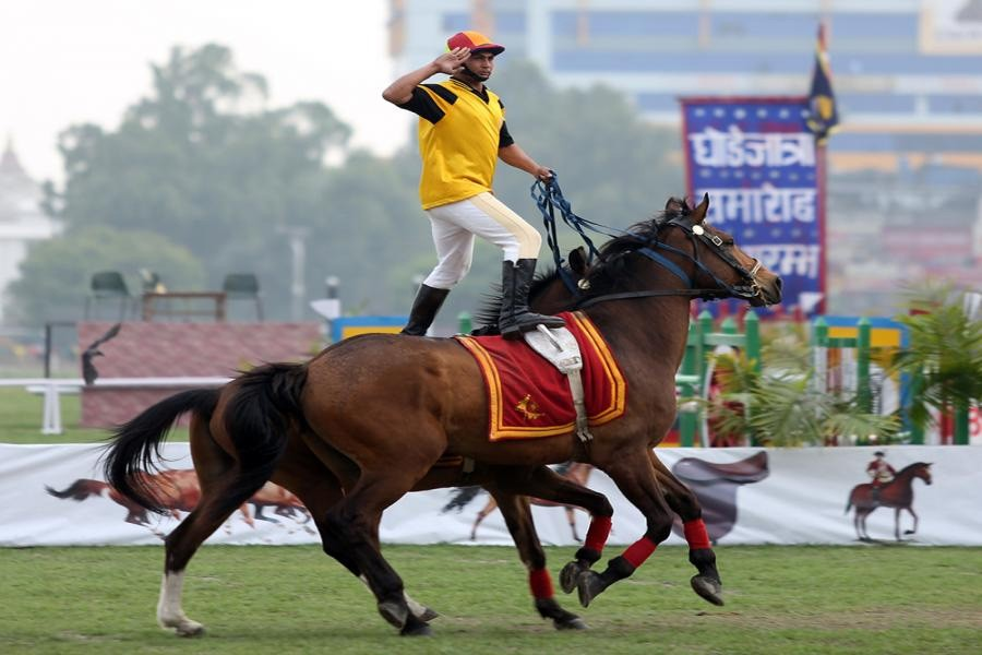 File Photo: Nepal Army man showing his skill standing over horse on Ghode Jatra Day in Tundikhel,
