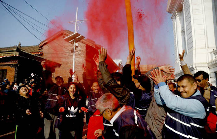 People enjoying with red vermilion after erection of Chir at Basantapur on Tuesday. Photo credit: Reportersnepal
