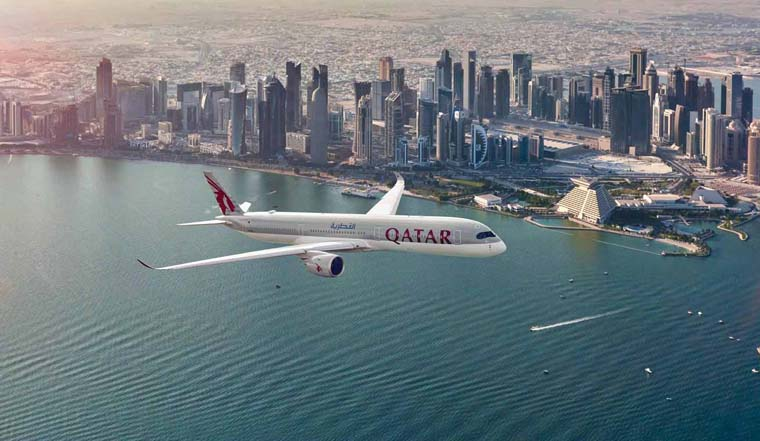 Buildings are seen from across the water in Doha along with Qatar Airways Flight. Photo: qatarairways.com