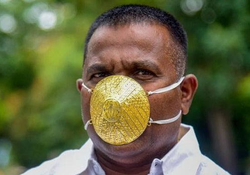 Man wears gold mask