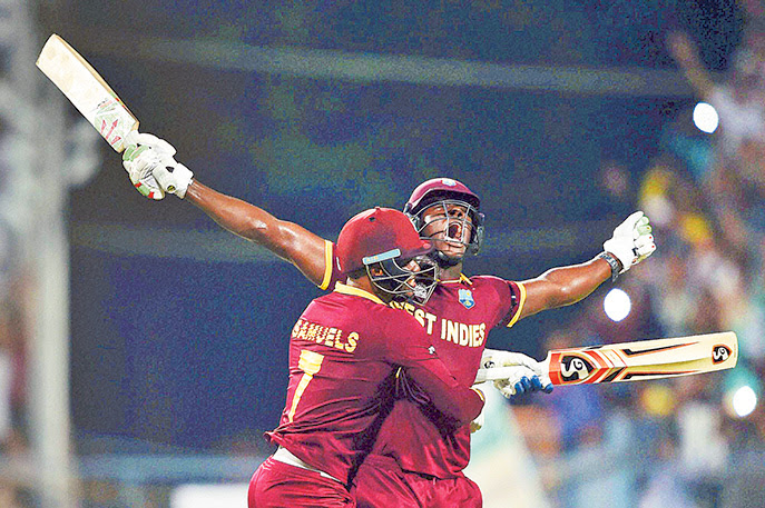 File photo: West Indies' Carlos Brathwaite (right) is ecstating in 2016. But, cricket fans will have to wait almost three years for the next edition. PTI image