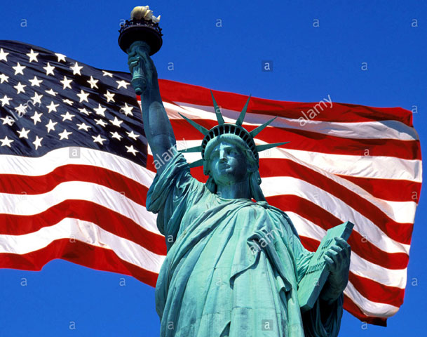 Statue of Liberty and American Flag. Alamy Stock photo