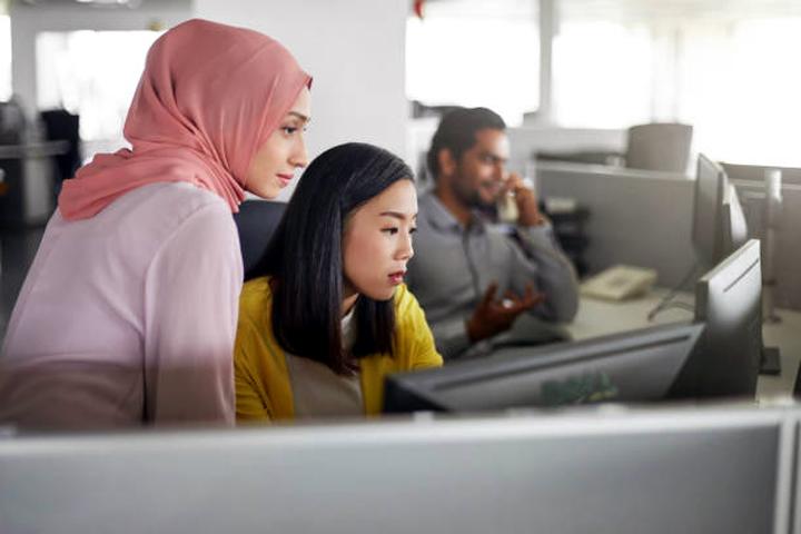Muslim women wearing headscarf at work iStock photo