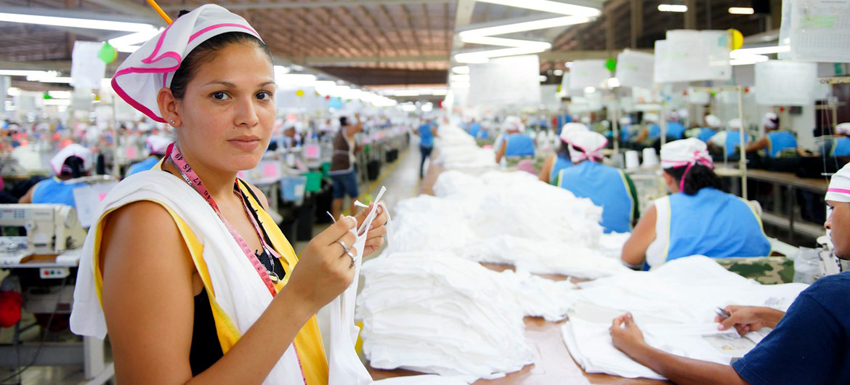 A garment worker inspects clothing in a factory in Nicaragua. ILO Photo/Marcel Crozet