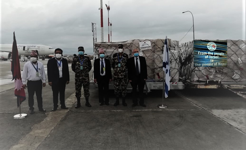 Ambassador of Israel to Nepal Hanan Goder (right) handing over the medical equipment to the representatives of the Covid-19 Crisis Management Centre (CCMC) and Ministry of Health amidst a function organised Thursday at the Tribhuvan International Airport. Israeli Embassy Photo
