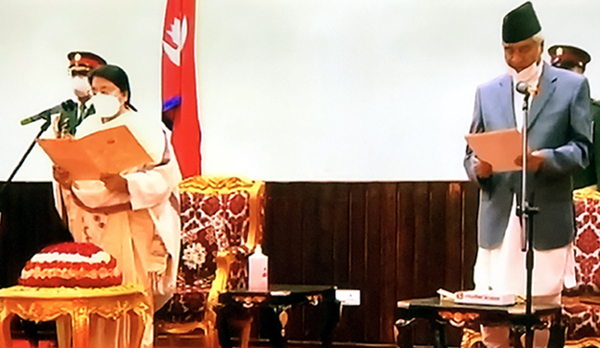 Nepal's President Bidya Devi Bhandari (left) swearing oath-of-administer to the newly appointed Prime Minister amidst a special function at President's House, Sheetal Niwas Tuesday evening. TV Image