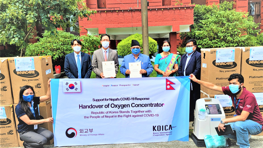 State Minister for Health and Population Umesh Shrestha (exact middle with cap) receiving Korean medical aid from the Ambassador of the Republic of Korea to Nepal Park Chong-suk (second from left) at a handover ceremony organized at the premise of the Ministry on August 31, 2021 Tuesday. KOICA Photo