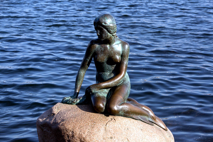 """The """"Little Mermaid"""" statue in Langelinie harbor, in Copenhagen. The sculpture was a gift to the city in 1913. Credit Ole Jensen/Getty Images"""