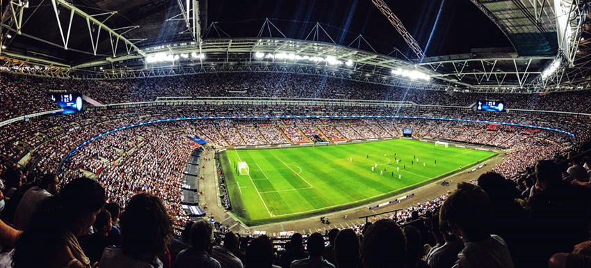 A crowd watching a football game inside Wembley Stadium in England. File photo: Mitch Rosen