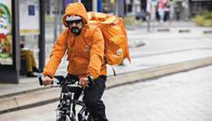 Former Afghan Minister Sayed Sadaat working as a delivery-man riding bicycle Germany.